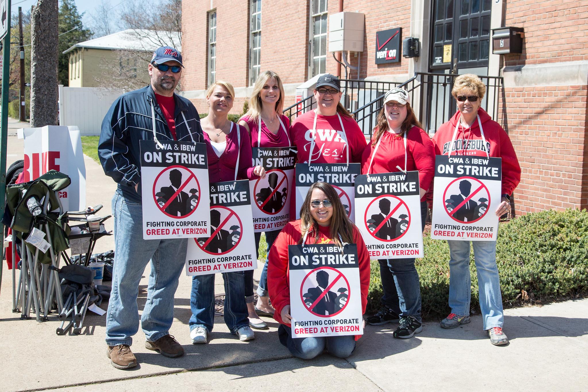 CWA and IBEW workers on strike